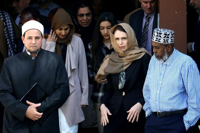 Jacinda Ardern walks with Al Noor mosque Iman Gamal Fouda ahead of unveiling a plaque in memory of the victims killed in the 2019 shootings