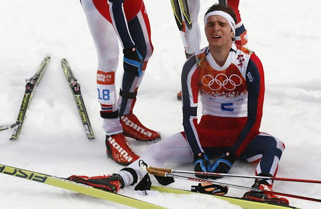 Norway's Joergen Graabak catches his breath after winning the gold during the Nordic combined individual Gundersen large hill competition at the 2014 Winter Olympics, Tuesday, Feb. 18, 2014, in Krasnaya Polyana, Russia. (AP Photo/Dmitry Lovetsky)
