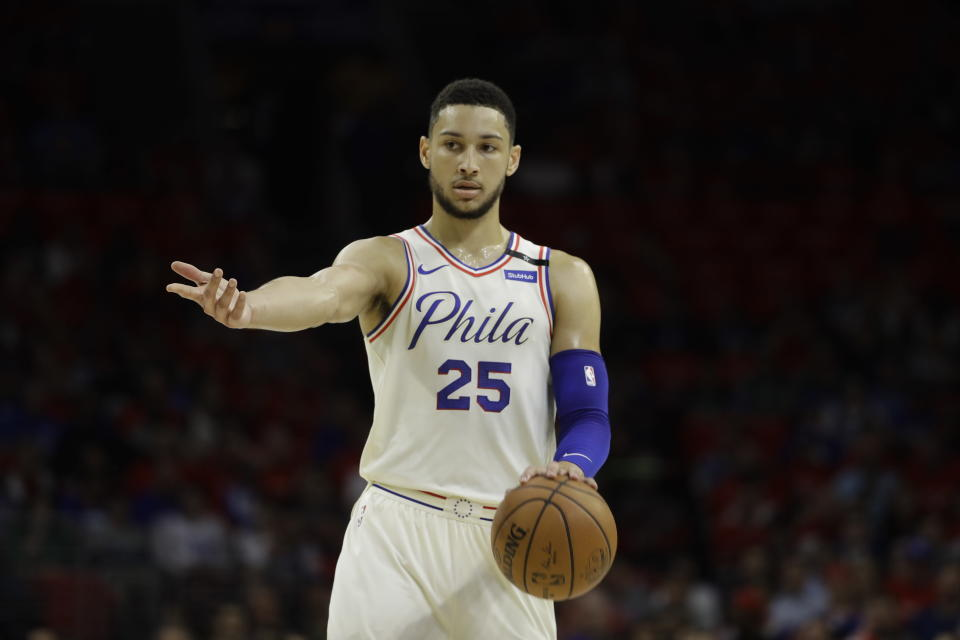 """<a class=""""link rapid-noclick-resp"""" href=""""/nba/teams/phi"""" data-ylk=""""slk:Philadelphia 76ers"""">Philadelphia 76ers</a> star <a class=""""link rapid-noclick-resp"""" href=""""/nba/players/5600/"""" data-ylk=""""slk:Ben Simmons"""">Ben Simmons</a> dribbles with his left hand and points with his right. (AP)"""