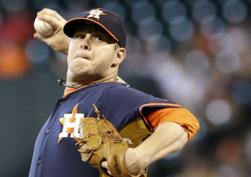 Houston Astros' Brad Peacock delivers a pitch against the Boston Red Sox in the first inning of a baseball game Sunday, July 13, 2014, in Houston. Peacock was pulled in the first after giving up two hits, one run and loading the bases with only one out. (AP Photo/Pat Sullivan)