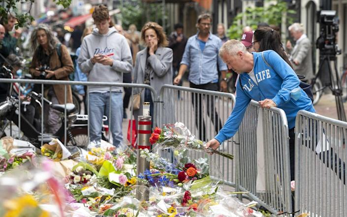 In central Amsterdam, people laid flowers in Mr de Vries' memory - Shutterstock