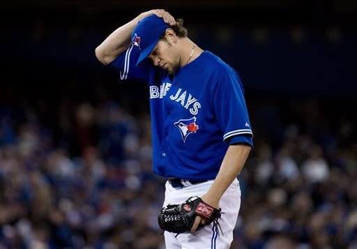 Toronto Blue Jays starting pitcher Josh Johnson looks down while playing against the Boston Red Sox during fifth-inning baseball game action in Toronto, Friday, April 5, 2013. (AP Photo/The Canadian Press, Nathan Denette)