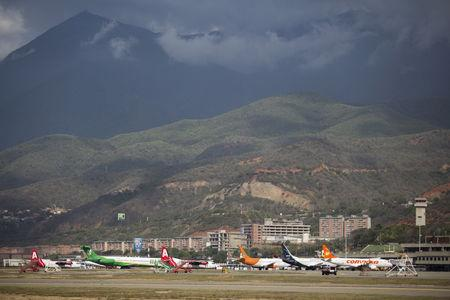 FILE PHOTO: Aircraft are seen at a runway on the Simon Bolivar airport in Caracas July 17, 2015. REUTERS/Marco Bello/File Photo