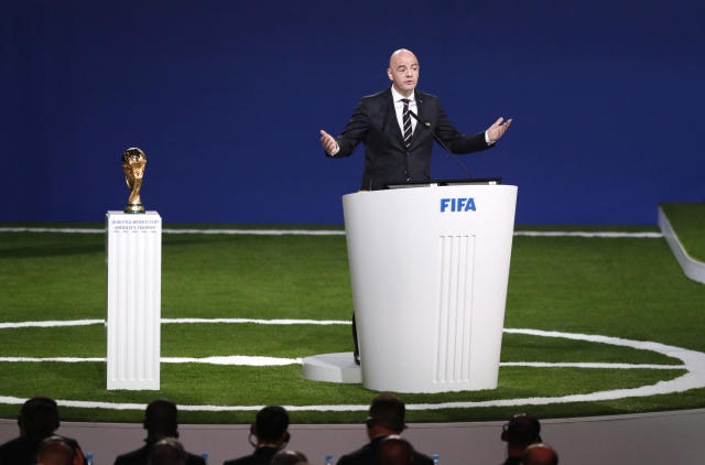 FIFA President Gianni Infantino delivers a speech beside World Cup trophy at the FIFA congress on the eve of the opener of the 2018 soccer World Cup in Moscow, Russia, Wednesday, June 13, 2018. The congress in Moscow is set to choose the host or hosts for the 2026 World Cup. (AP Photo/Pavel Golovkin)
