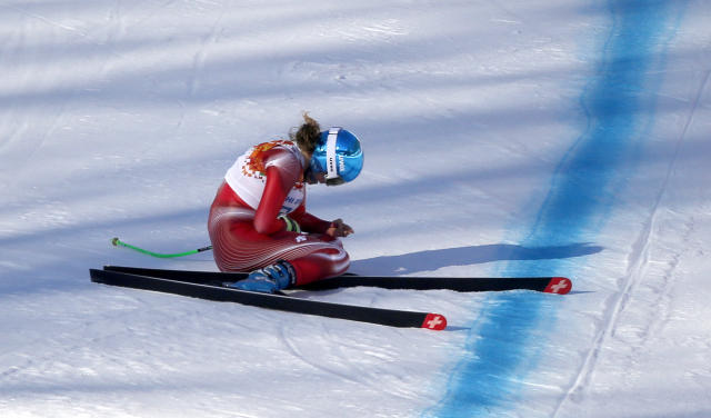 Switzerland's Nadja Jnglin-Kamer sits after crashing near the finish line during a women's downhill training run for the Sochi 2014 Winter Olympics, Saturday, Feb. 8, 2014, in Krasnaya Polyana, Russia.(AP Photo/Christophe Ena)