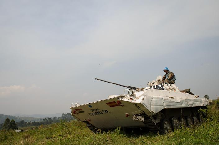 A United Nations tank stands guard outside the village of Kibumba I in the Democratic Republic of the Congo's restive North Kivu province on July 11, 2012 (AFP Photo/Phil Moore)
