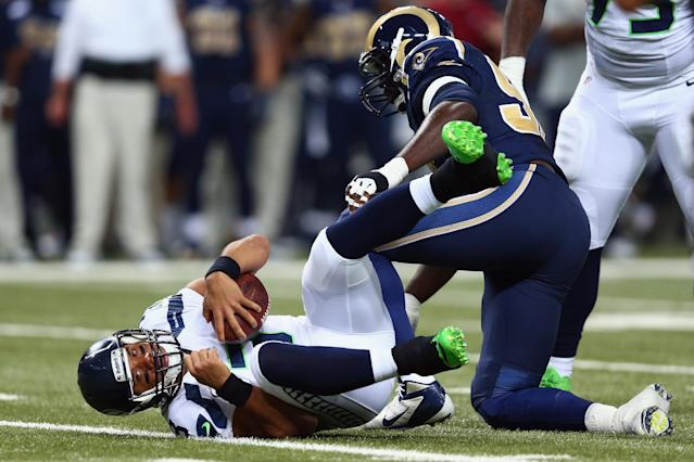 ST LOUIS, MO - OCTOBER 28: Russell Wilson #3 of the Seattle Seahawks gets sacked by William Hayes #95 the St. Louis Rams during an NFL game at Edward Jones Dome on October 28, 2013 in St Louis, Missouri. (Photo by Andy Lyons/Getty Images)