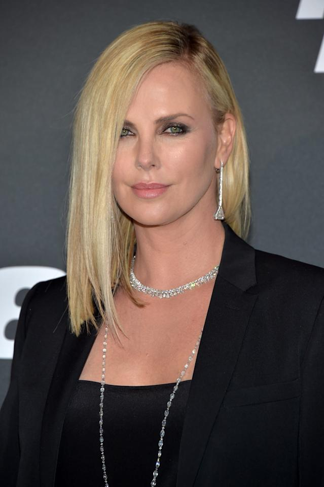 <p>Sleek and sexy, Theron attended the <em>Fast & Furious 8</em> Paris premiere sporting a straight blond lob and gray smoky eyeshadow. Petal-pink lipstick added warmth to her fair complexion. (Photo: Getty Images) </p>