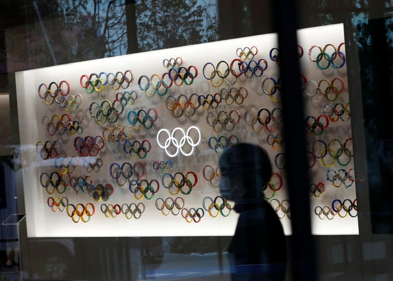 A woman wearing a protective face mask, following an outbreak of the coronavirus disease, is seen inside closed Japan Olympics Museum, in Tokyo, Japan