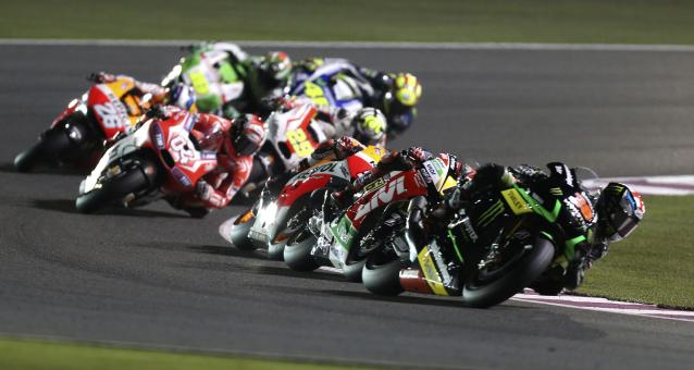 Monster Yamaha Tech 3 Bradley Smith of Britain leads a group during the Qatar MotoGP Grand Prix at the Losail International circuit in Doha March 23, 2014. REUTERS/Stringer (QATAR - Tags: SPORT MOTORSPORT)