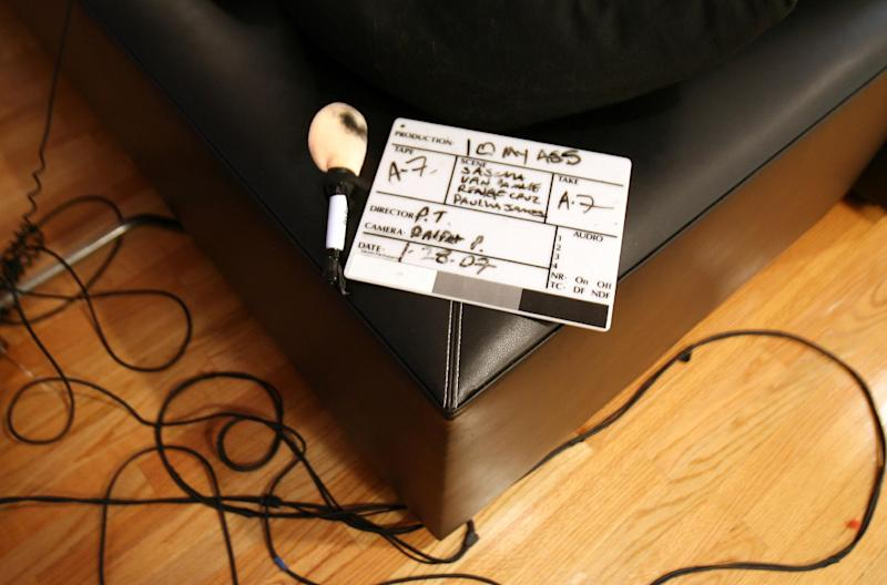 A clapper board on the set of a pornographic movie in Los Angeles, on January 29, 2007 (AFP Photo/Gabriel Bouys)