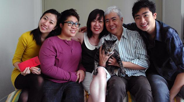 Theresa Goh's family and their cat, Abby. (From left to right) Goh's sister Marisa, 23; Goh; Goh's mother Rose Mok, 53; Goh's father Bernard, 54; and Goh' brother Nicholas. 20. (Theresa Goh photo)