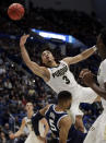 <p>Purdue's Carsen Edwards (3) drives and is fouled by Villanova's Phil Booth (5) during the first half of a second round men's college basketball game in the NCAA Tournament, Saturday, March 23, 2019, in Hartford, Conn. (AP Photo/Elise Amendola) </p>