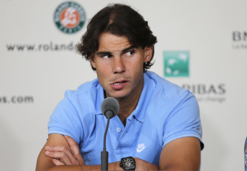 Spain's Rafael Nadal listens to a reporter during a press conference for the 2013 French Open tennis tournament, at Roland Garros stadium in Paris, Friday May, 24, 2013. (AP Photo/Christophe Ena)
