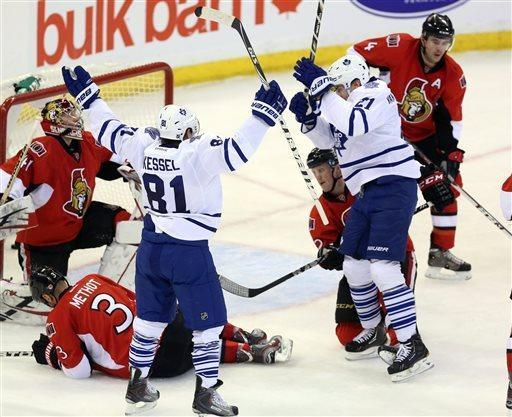 Maple Leafs' Phil Kessel (81) celebrates a goal by teammate James van Riemsdyk (21) during second period NHL action against the Ottawa Senators in Ottawa Saturday April 20, 2013. (AP Photo/The Canadian Press, Fred Chartrand)