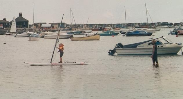 Emma Wilson immediately took to the water at Christchurch Harbour under the watchful eye of mum Penny. (Photo: Supplied by the Wilsons)