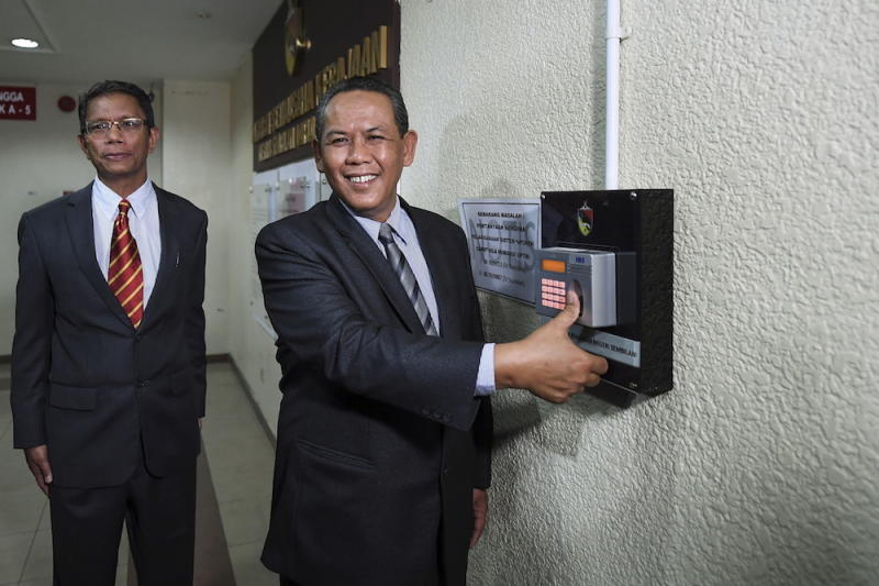 Negri Sembilan MB Aminuddin Harun says it is not unusual for a mentri besar to hold multiple portfolios, and pointed out that his Datuk Seri Mohamad Hasan had done the same. — Bernama pic