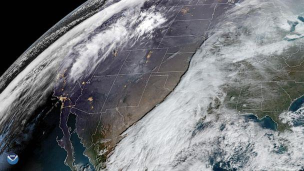 PHOTO: Two storms are shown moving across the United States on Dec. 20, 2019, that may hinder holiday travel through next week. (NOAA via ZUMA Press via Newscom)