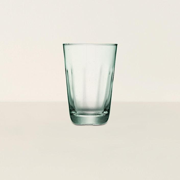 """Not only is this set of four glasses durable and classy, but the pieces are made of recycled glass too. These feel like they would be best served with some bubbles and a wedge of lemon. $45, Goodee. <a href=""""https://www.goodeeworld.com/collections/drinkware/products/mia-highball"""" rel=""""nofollow noopener"""" target=""""_blank"""" data-ylk=""""slk:Get it now!"""" class=""""link rapid-noclick-resp"""">Get it now!</a>"""