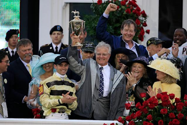 Jockey Flavien Prat and trainer Bill Mott of Country House celebrate with the trophy after winning the 145th running of the Kentucky Derby. (Getty Images)