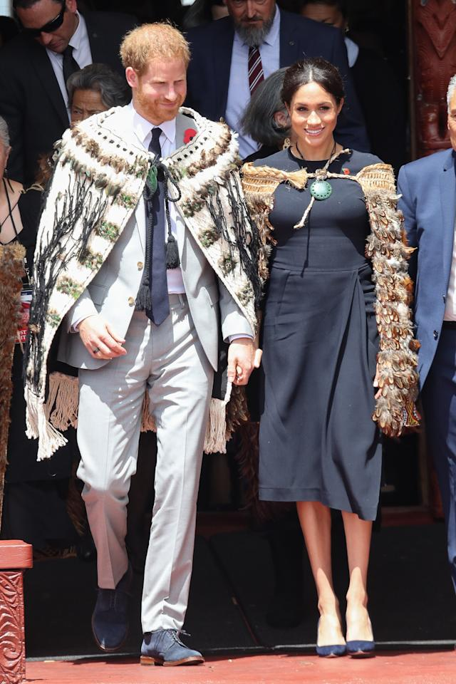 <p>On October 31, the Duchess of Sussex arrived in Rotorua wearing a bespoke Stella McCartney dress. She later added a traditional 'Korowai' to her ensemble. <em>[Photo: Getty]</em> </p>