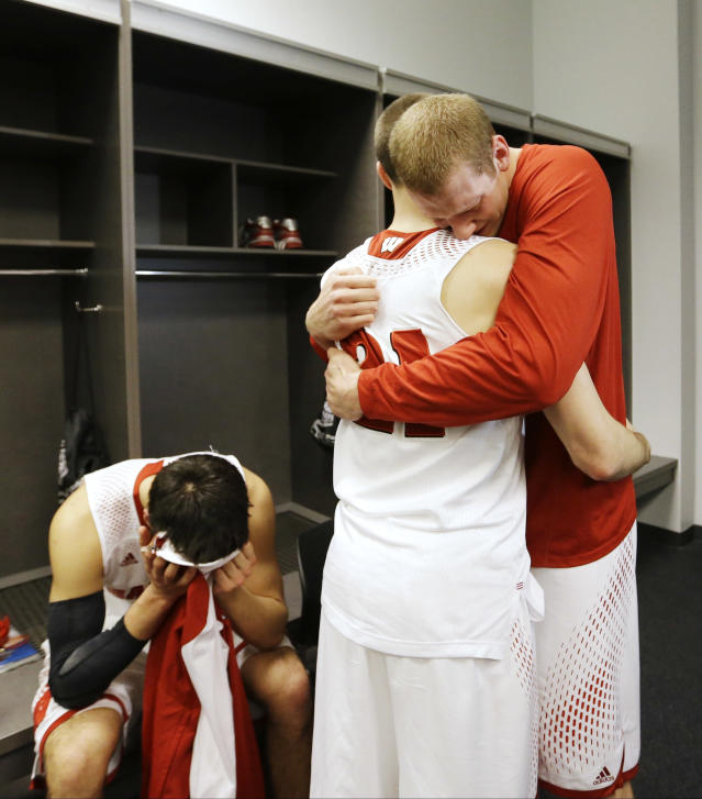 From left, Wisconsin's Duje Dukan, Josh Gasser, and Evan Anderson are dejected in the locker room after losing to Kentucky 74-73 at their NCAA Final Four tournament college basketball semifinal game Saturday, April 5, 2014, in Arlington, Texas. (AP Photo/David J. Phillip)