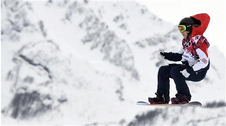 Britain's Jenny Jones performs a jump during the women's snowboard slopestyle finals event at the 2014 Sochi Winter Olympics in Rosa Khutor, February 9, 2014. REUTERS/Dylan Martinez