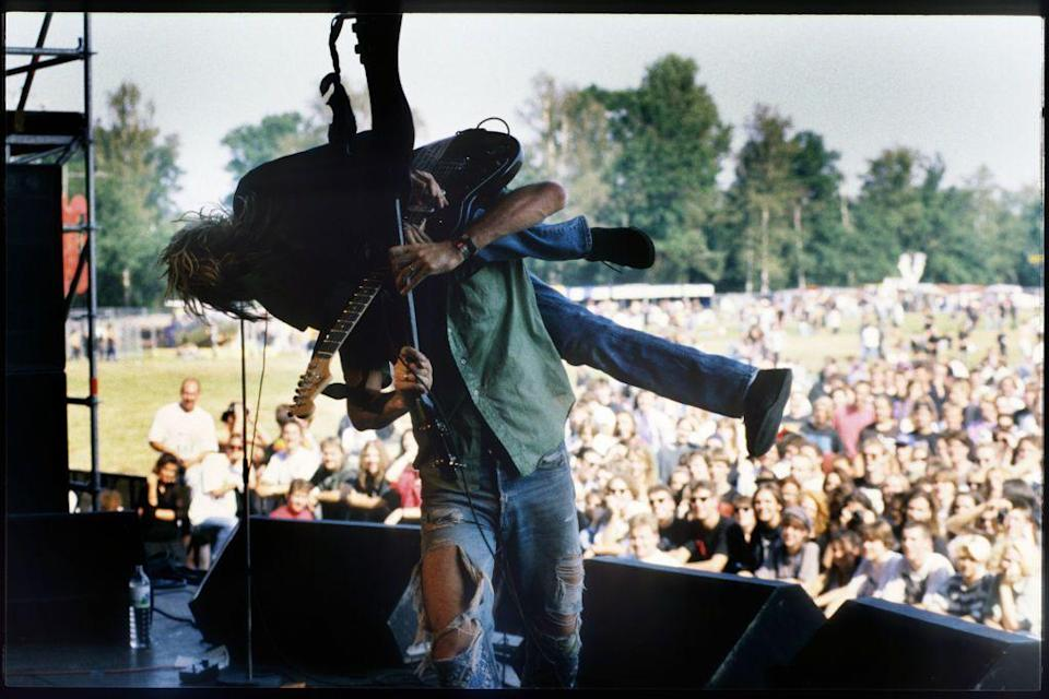 <p>Krist Novoselic picks up Kurt Cobain over his head during the performance. Novoselic, the bassist, has formed two other bands since the passing of Cobain and disbanding of Nirvana: Sweet 75 in 1995 and later Eyes Adrift. </p>