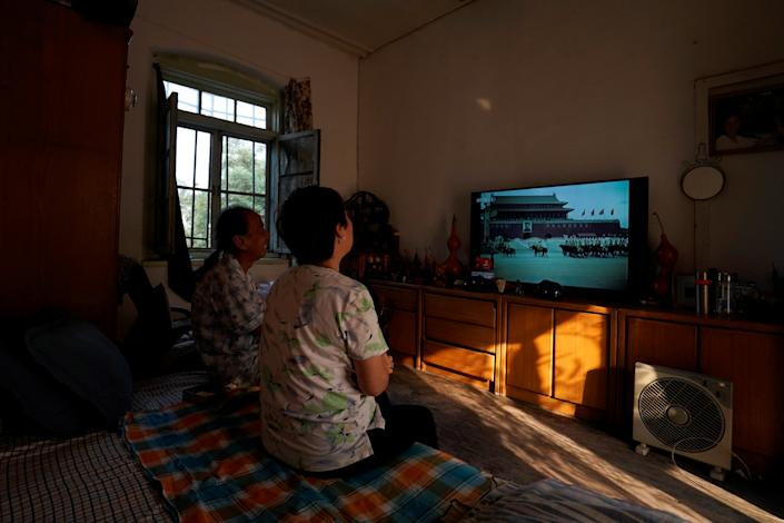 Residents watch on television the 1949 parade marking the establishment of People's Republic of China, before a military parade marking its 70th founding anniversary, on its National Day in Beijing, China October 1, 2019. (Photo: Aly Song/Reuters)