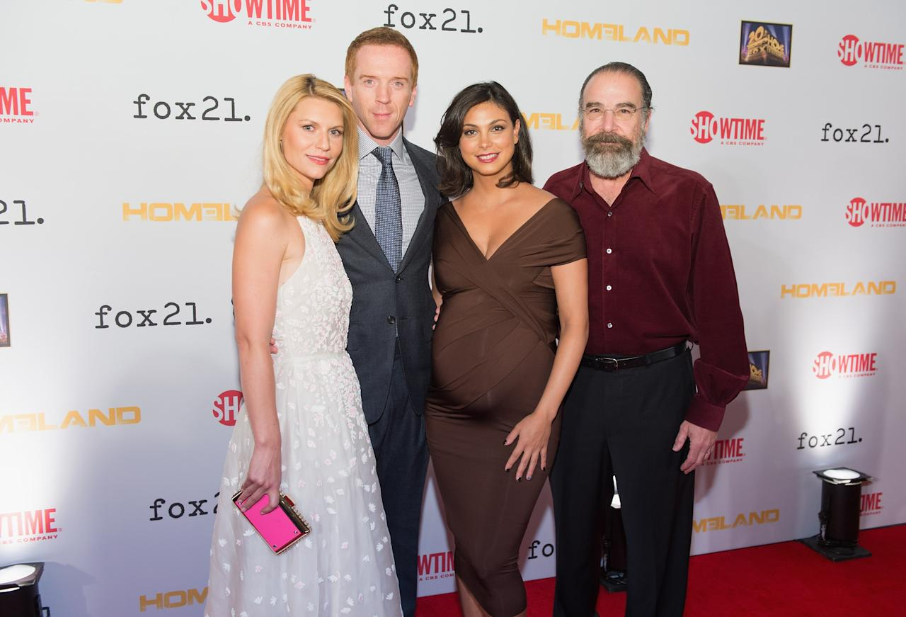 "WASHINGTON, DC - SEPTEMBER 09: (L-R) Claire Danes, Damian Lewis, Morena Baccarin and Mandy Patinkin attend a premiere screening hosted by SHOWTIME and Fox 21 for Season 3 of the hit series ""Homeland"" at Corcoran Gallery of Art on September 9, 2013 in Washington City. (Photo by Daniel Boczarski/Getty Images for Showtime)"