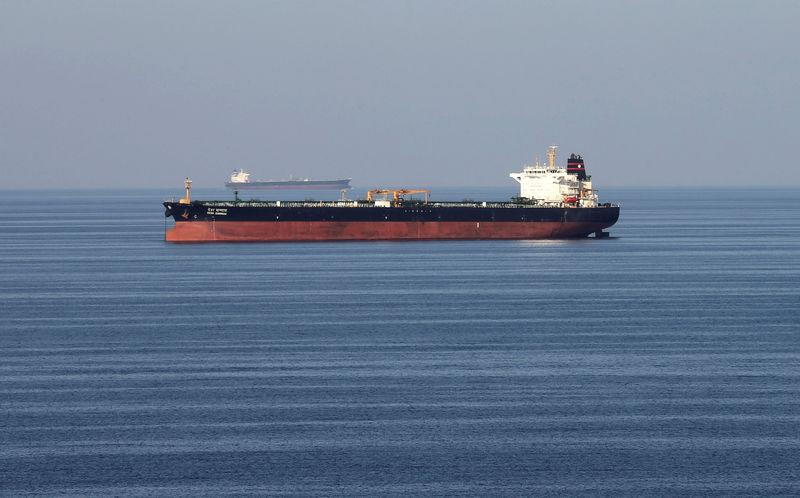 FILE PHOTO: Oil takners pass through the Strait of Hormuz