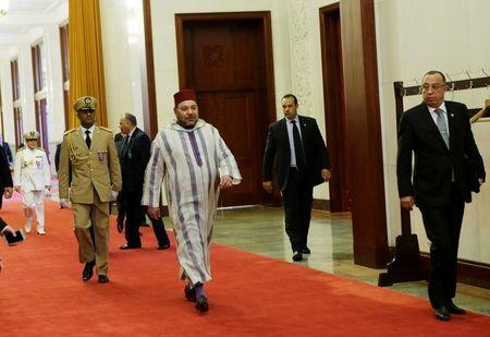 Moroccan King, Mohammed VI (C), arrives at the Great Hall of People for a meeting with China's Premier Li Keqiang (not in picture) in Beijing, China May 12, 2016. REUTERS/Jason Lee