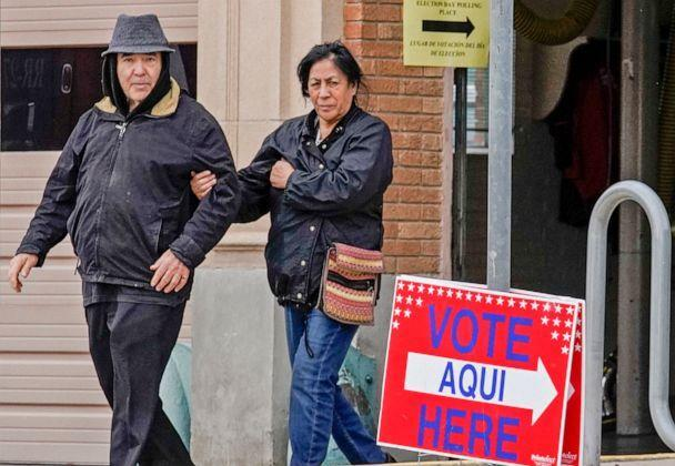 PHOTO: Julio Villalobos and Lucy Martinez Aguirre leave El Paso Fire Station 3 after casting their votes in the presidential primary in El Paso, Texas on Super Tuesday, March 3, 2020.  (Paul Ratje/AFP via Getty Images)