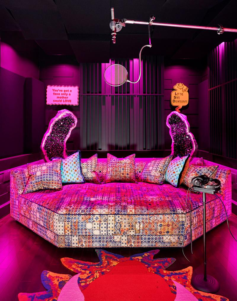 A Ferris Rafauli custom daybed wears a Jean Paul Gaultier textile in the recording studio. The accent pillows, also by Rafauli, are made of Jonas Wood x Louis Vuitton Monogram silk scarves.