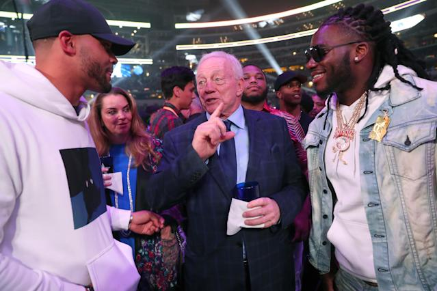 Dallas Cowboys owner Jerry Jones talks with Dallas Cowboys quarterback Dak Prescott (L) and defensive end DeMarcus Lawrence before (R) Errol Spence Jr takes on Mikey Garcia in an IBF World Welterweight Championship bout at AT&T Stadium on March 16, 2019 in Arlington, Texas. (Photo by Tom Pennington/Getty Images)