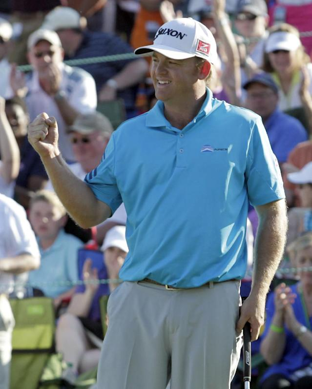 J.B. Holmes reacts after winning the Wells Fargo Championship golf tournament in Charlotte, N.C., Sunday, May 4, 2014. (AP Photo/Bob Leverone)