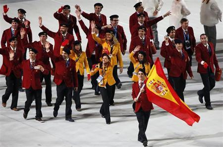 Spain's flag-bearer Javier Fernandez leads his country's contingent during the opening ceremony of the 2014 Sochi Winter Olympics, February 7, 2014. REUTERS/Grigory Dukor