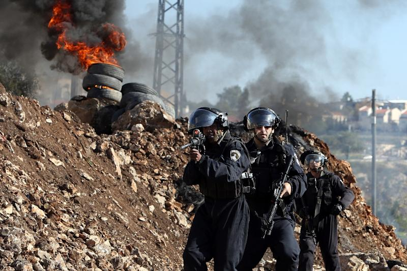 Israeli border guards during clashes with Palestinian protesters on December 25, 2015 in the occupied West Bank (AFP Photo/Jaafar Ashityeh)