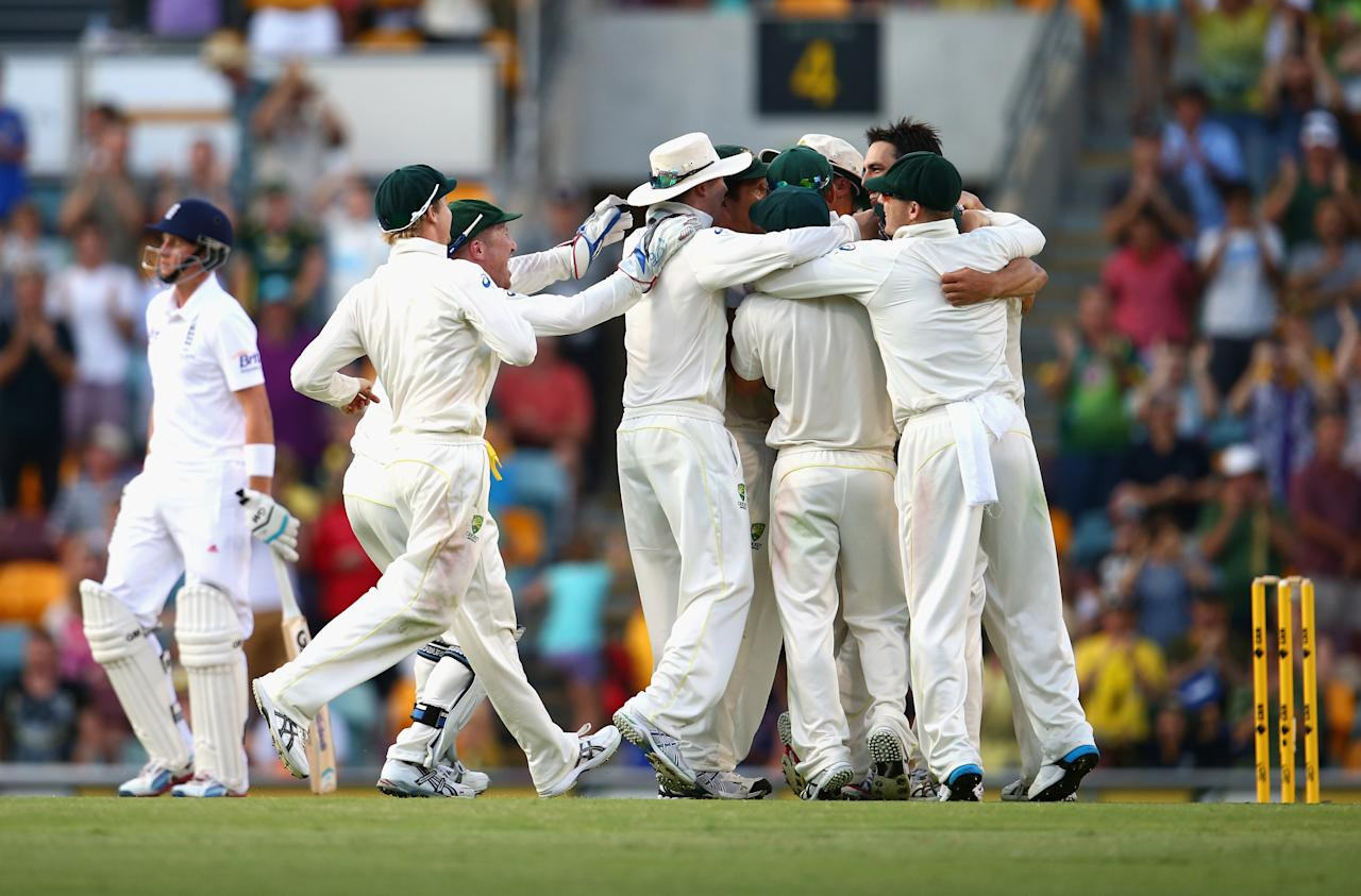 BRISBANE, AUSTRALIA - NOVEMBER 24:  Mitchell Johnson of Australia celebrates after taking the wicket of James Anderson of England to claim victory during day four of the First Ashes Test match between Australia and England at The Gabba on November 24, 2013 in Brisbane, Australia.  (Photo by Ryan Pierse/Getty Images)