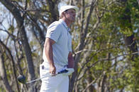 Bryson DeChambeau watcher his shot from the third tee during the final round of the Arnold Palmer Invitational golf tournament Sunday, March 7, 2021, in Orlando, Fla. (AP Photo/John Raoux)