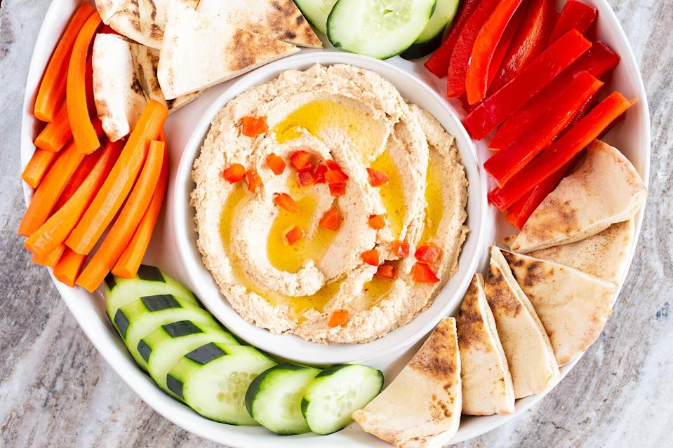 <p>Is there anything cauliflower can't do? This versatile ingredient subs for chickpeas in a lightened-up version of hummus that's just as flavorful and zingy as the original.</p>