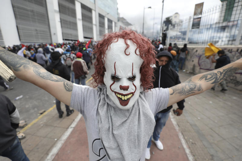 An anti-government demonstrator poses with a clown mask during clashes with the police as he protests against President Lenin Moreno and his economic policies, in Quito, Ecuador, Oct. 8, 2019. (Photo: Fernando Vergara/AP)