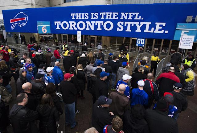 Fans enter the Rogers Centre before the Buffalo Bills play the Atlanta Falcons in NFL football action in Toronto, Sunday Dec. 1, 2013. (AP Photo/The Canadian Press, Mark Blinch)