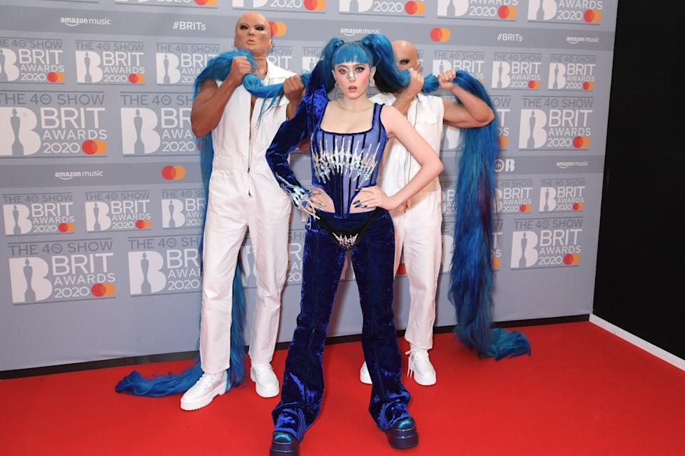 Ashnikko needed two people to hold up her hair in this superhero-inspired ensemble. (Getty Images)