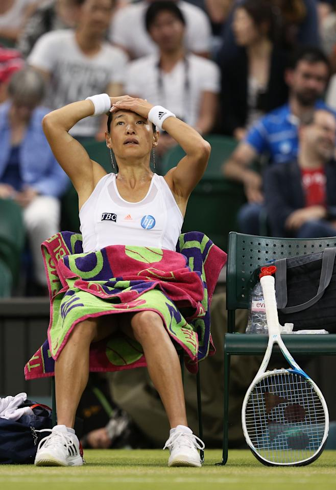 LONDON, ENGLAND - JUNE 29: Kimiko Date-Krumm of Japan reacts during a break in the Ladies' Singles third round match against Serena Williams of the United States of America on day six of the Wimbledon Lawn Tennis Championships at the All England Lawn Tennis and Croquet Club on June 29, 2013 in London, England. (Photo by Clive Brunskill/Getty Images)