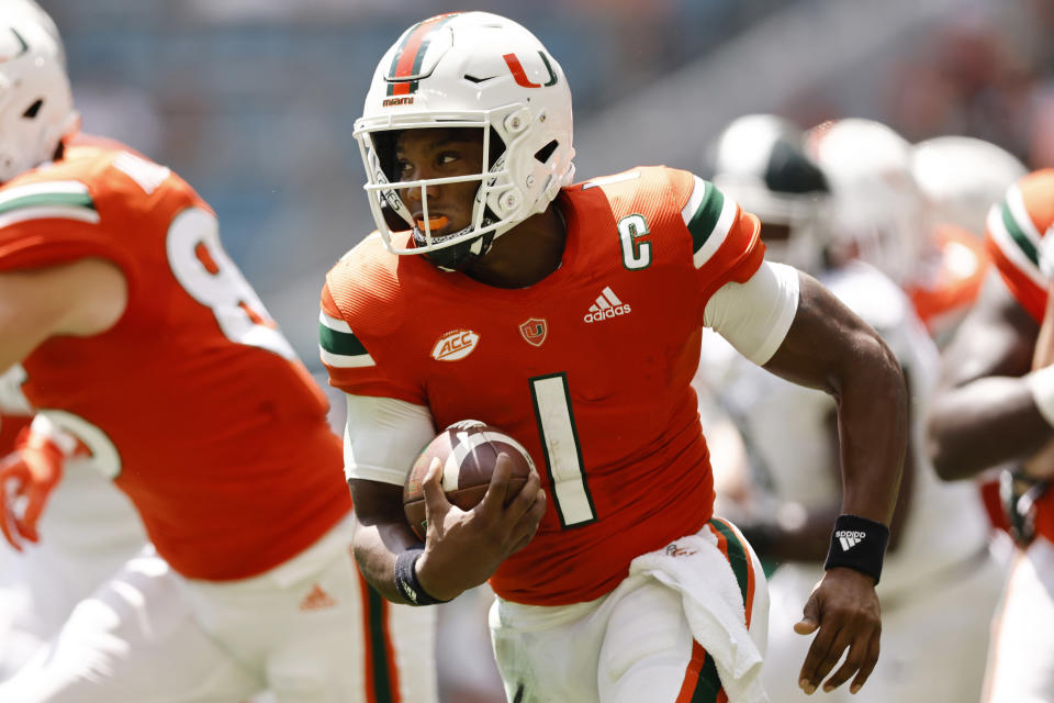 Miami quarterback D'Eriq King (1) runs with the ball during the first quarter of an NCAA college football game against Michigan State, Saturday, Sept. 18, 2021, in Miami Gardens, Fla. (AP Photo/Michael Reaves)