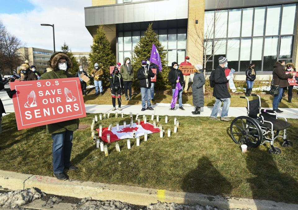 "<span class=""caption"">People protest outside the Tendercare Living Centre long-term-care facility in Scarborough, Ont. on Dec. 29, 2020. This LTC home has been hit hard by the second wave of the COVID-19 pandemic. </span> <span class=""attribution""><span class=""source"">(THE CANADIAN PRESS/Nathan Denette)</span></span>"