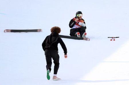 Freestyle Skiing - Pyeongchang 2018 Winter Olympics - Men's Ski Halfpipe Training - Phoenix Snow Park - Pyeongchang, South Korea - February 22, 2018 - Byron Wells of New Zealand reacts after crashing. REUTERS/Mike Blake