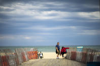 ASBURY PARK, NJ - MAY 4: People walk near the closed boardwalk due to the outbreak of COVID-19 in the state on May 4, 2020 in the Jersey Shore in New Jersey. Some towns at Jersey Shore expect the reopening of beaches soon. (Photo by Eduardo MunozAlvarez/VIEWpress/Corbis via Getty Images)