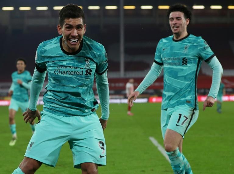 Bobby Dazzler: Roberto Firmino (left)and Curtis Jones (right) celebrate